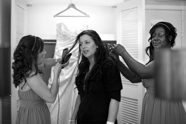 Two bridesmaids straighten a brides hair in Birmingham UK