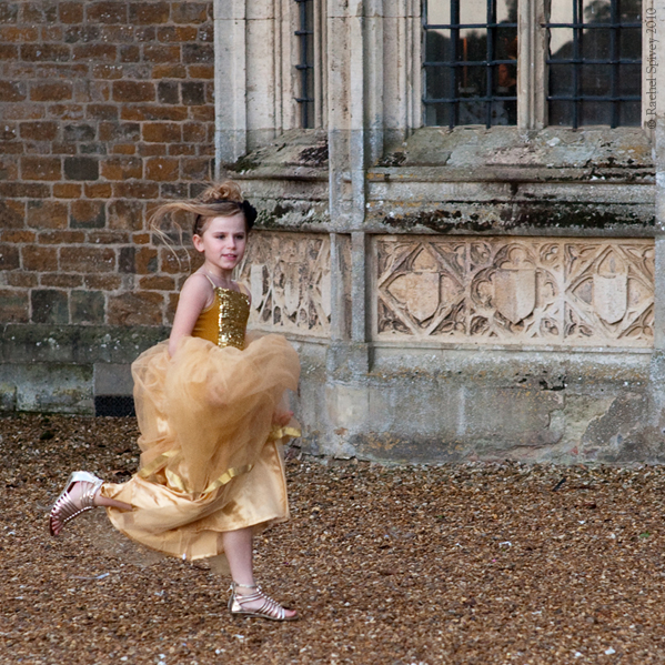 A young bridesmaid runs at a high class wedding