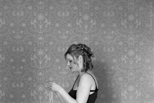 Young bride gets ready on her wedding day by Warwickshire-based photographer Rachel Spivey