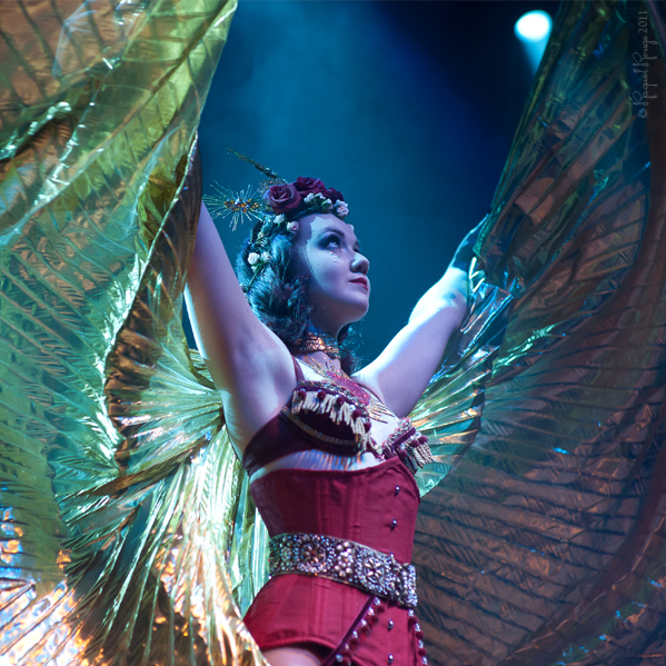 Young burlesque performer spreads her Isis wings