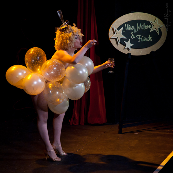 Burlesque star Missy Malone on stage at her eponymous revue
