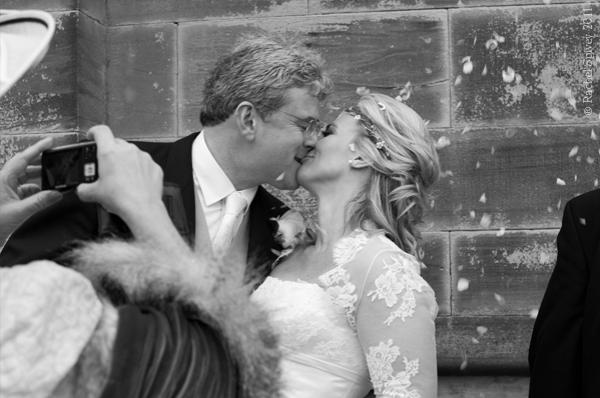 Warwickshire bride and groom kiss spontaneously