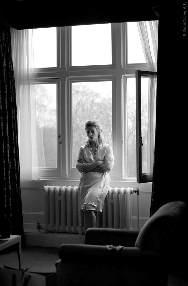 Contemplative bride by the window