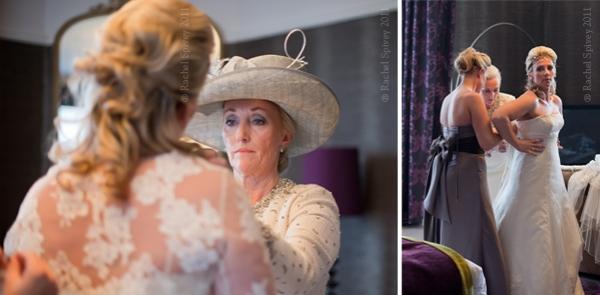 Bride's mother makes filan adjustments to her daughter's wedding dress