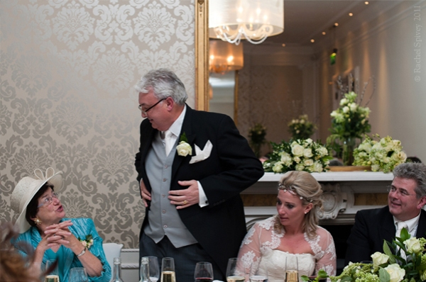 The father of the bride speaks at the top table