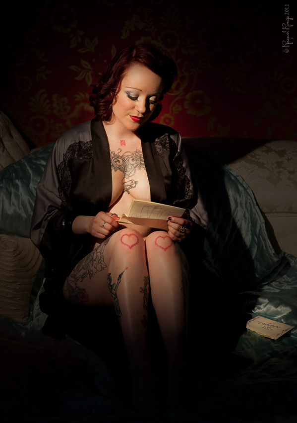 Sailor's girl reads a letter from her man – elegant and high class boudoir photography by Rachel Spivey, Leamington Spa