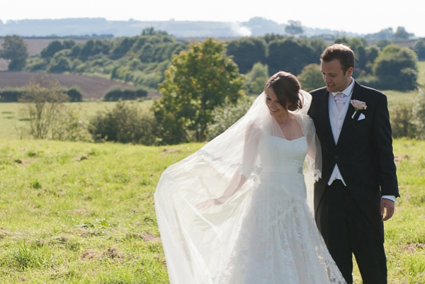 Informal bride and groom in the countryside by Rachel Spivey Warwickshire wedding photographer
