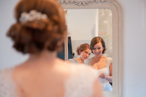 Bridesmaid and Bride reflected in the mirror