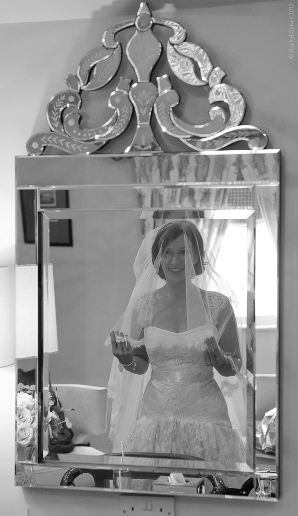 Pretty bride photographed in mirror by Rachel Spivey