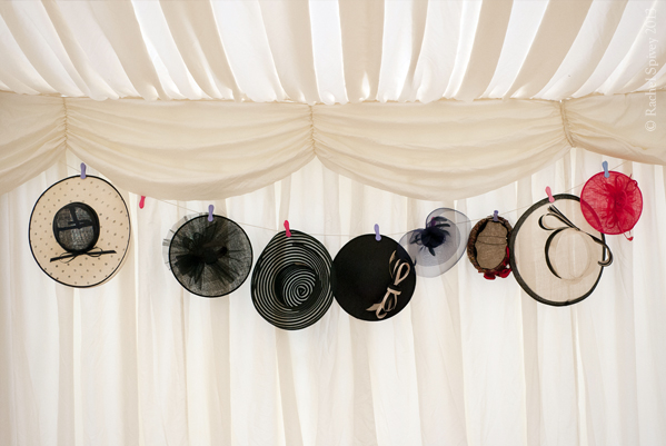 ladies hats hanging in marquee Clopton House Stratford upon avon by Leamington photographer Rachel Spivey
