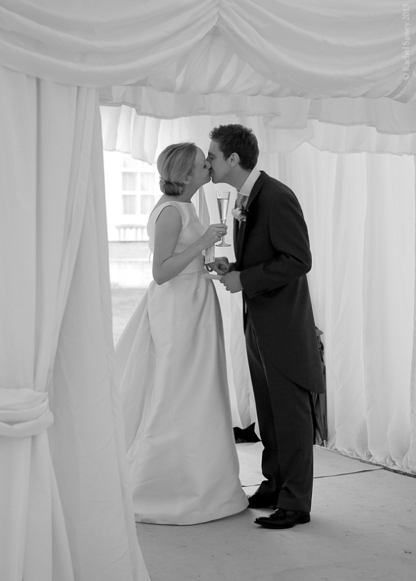 Champagne reception kiss bride and groom stratford upon avon warwickshire