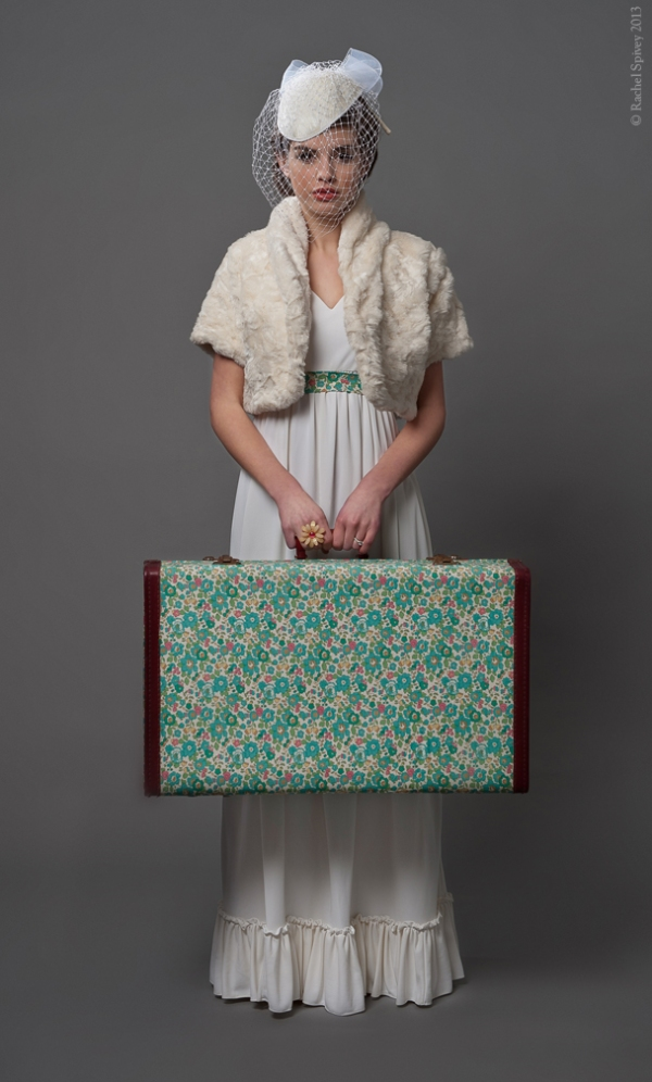 Vintage wedding going away outfit with liberty print suitcase