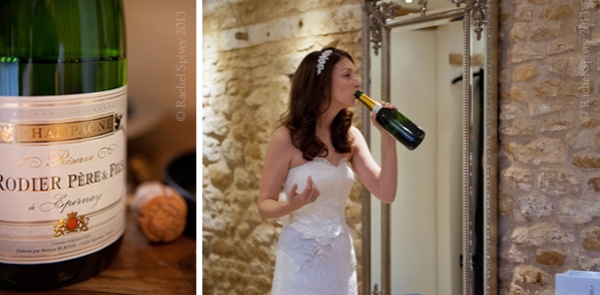 Bridal swigs champagne in a candid photo by Warwckshire wedding photographer Rachel Spivey