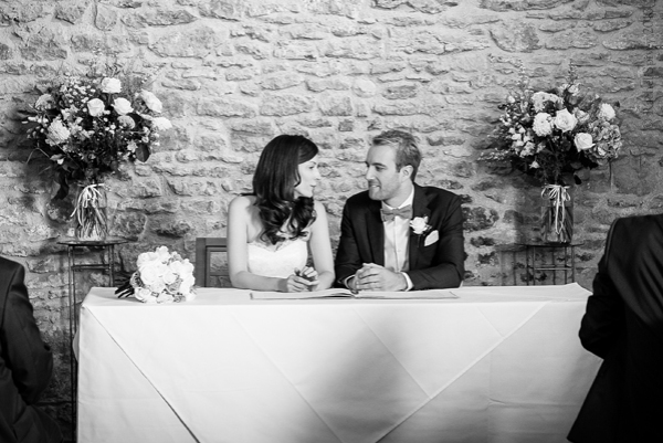 Bride and Groom sign the register by Warwckshire wedding photographer Rachel Spivey